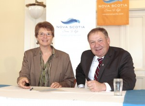 Heather Holm signing the Charter with Nova Scotia Premier Darrell Dexter